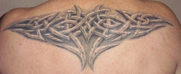 Realistic stone celtic knot tattoo on back