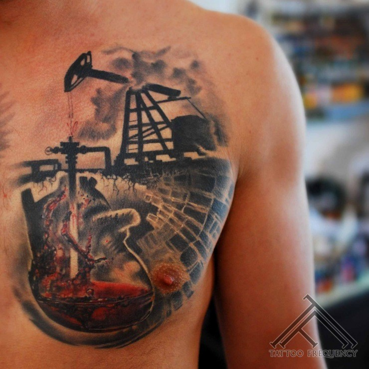 Realistic style colored oil mill tattoo on chest