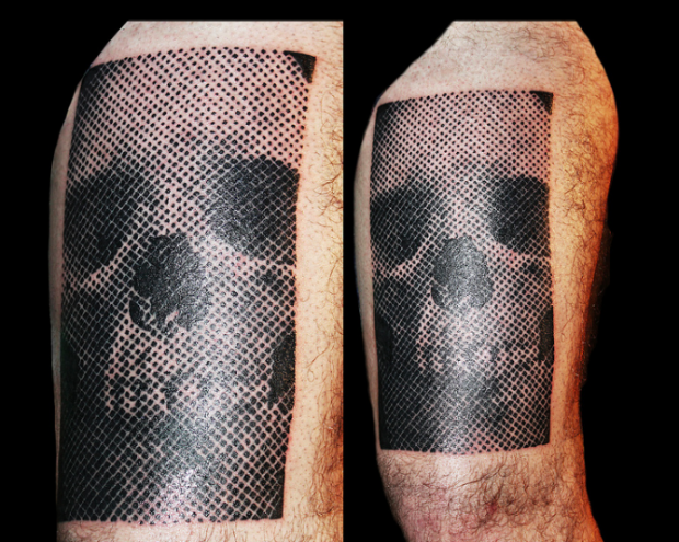 Rectangle shaped black and white human skull dotted work tattoo