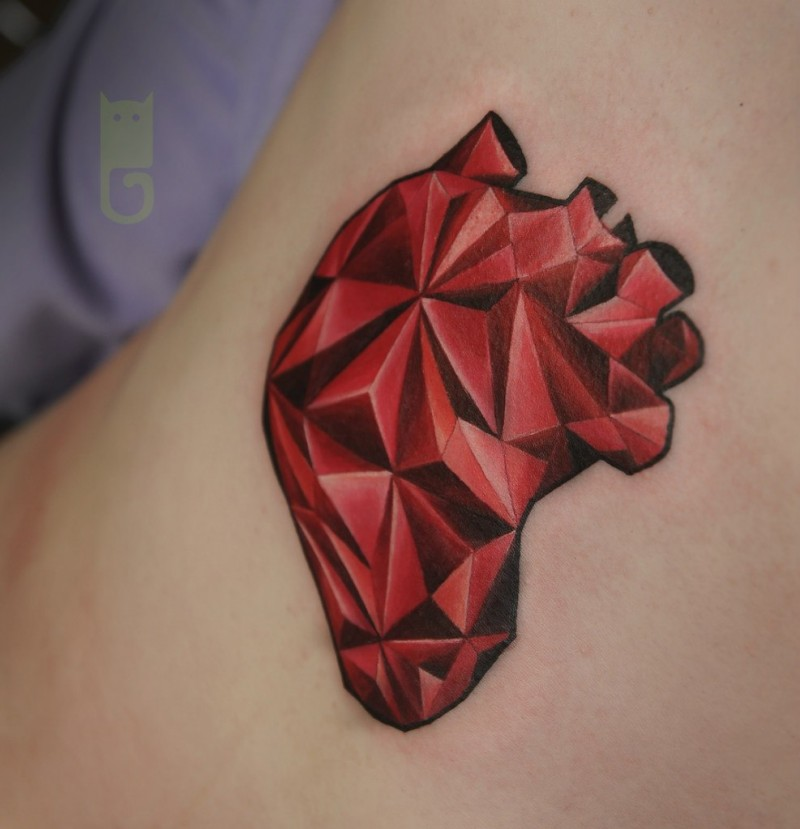 Red and black original design sharp human heart tattoo stylized with triangles