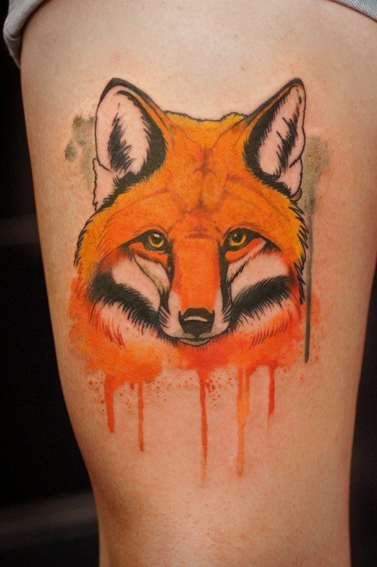 Red fox head tattoo on hip