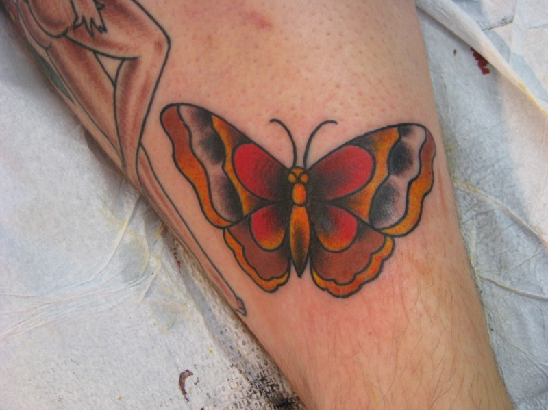 Red gray and yellow traditional butterfly tattoo