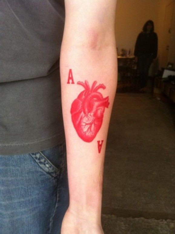 Red ink heart and letters forearm tattoo for Red ink tattoos