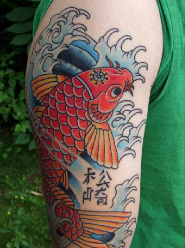 Red koi fish and hieroglyphs tattoo