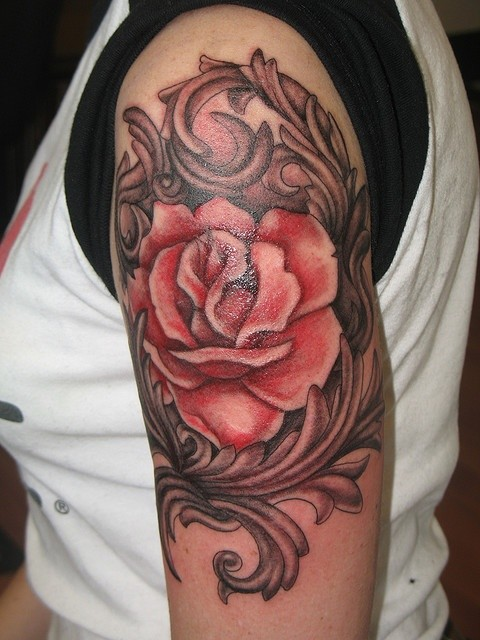 Red rose is surrounded by ornament tattoo on half sleeve for Rose sleeve tattoos