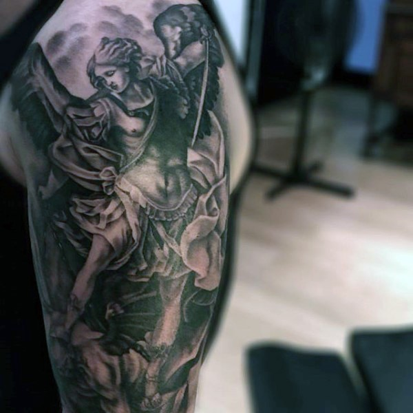 Religious paintings like black ink angel warrior fighting demons tattoo on upper arm