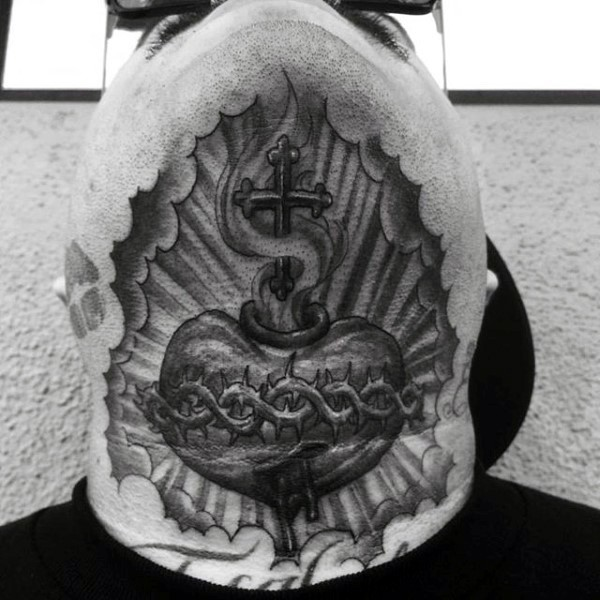 Religious themed black ink neck tattoo of human heart and cross