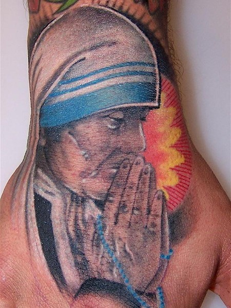 Religious themed colored praying woman tattoo on hand