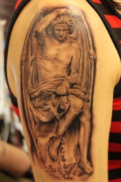 Renaissance angel with a chain on leg tattoo on half sleeve