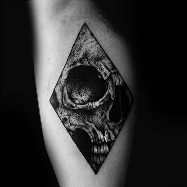 Rhombus shaped dotwork style biceps tattoo stylized with human skull