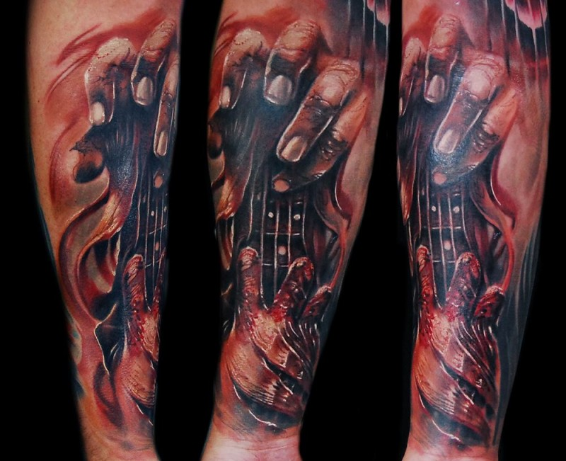 Ripped skin style colored forearm tattoo of bloody hands for Skin gallery tattoo