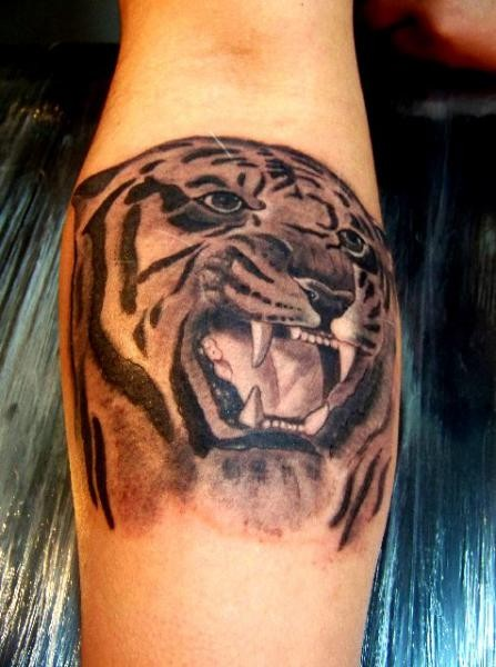 Roaring tiger head black ink  tattoo