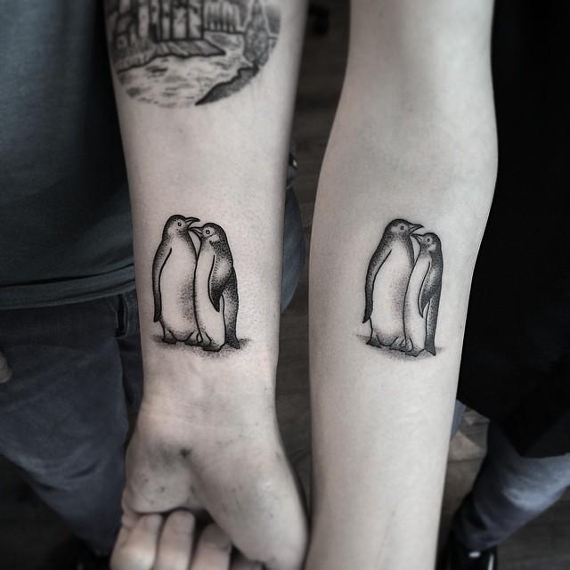 Romantic couple tattoo pair of penguins