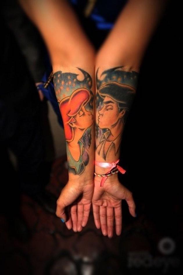 Romantic style colored forearm tattoo of ol cartoon couple