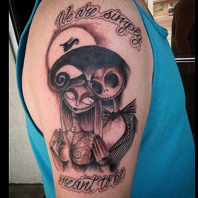 Romantic themed colored monster couple tattoo on shoulder with lettering