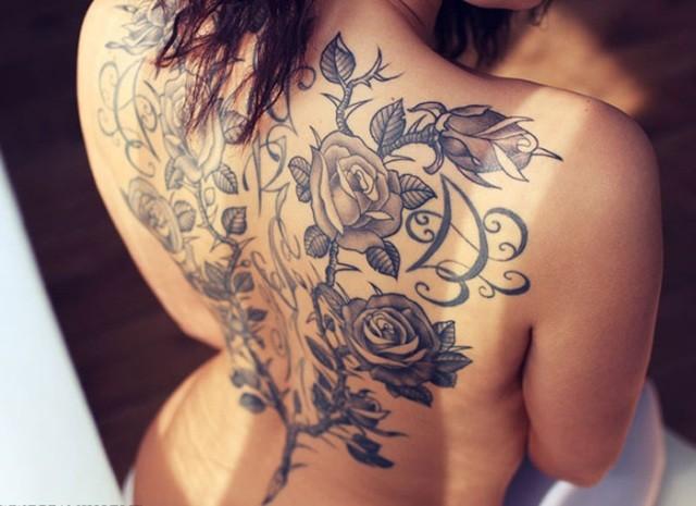 Roses tattoo on back for women