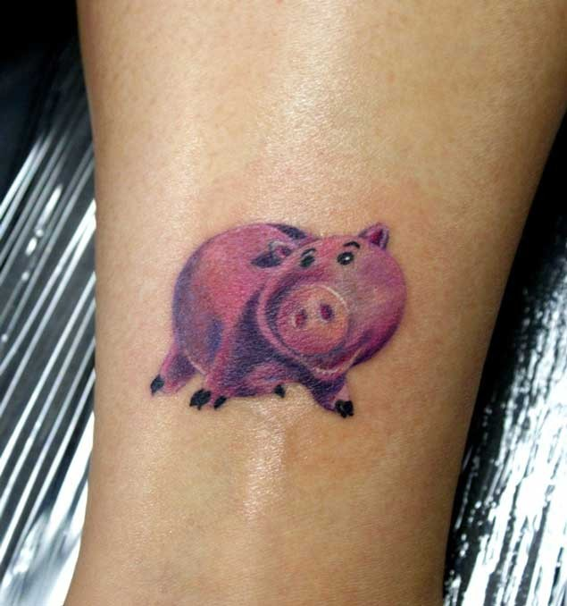 Rosy piggy bank funny colored detailed small size tattoo