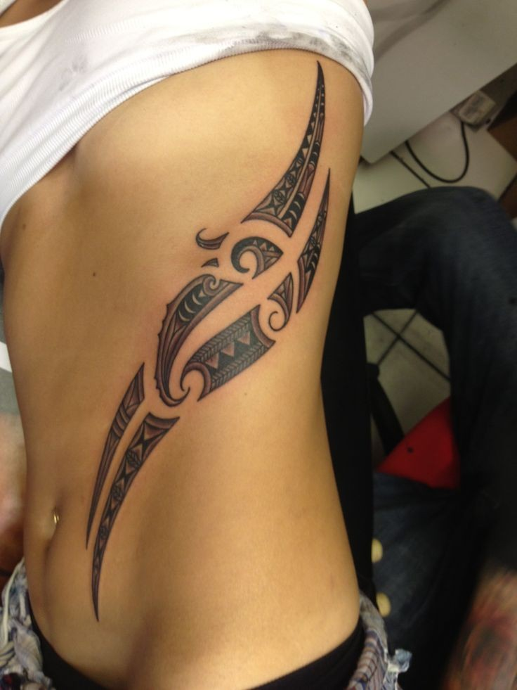 Rough-lined black tribal feather tattoo on side
