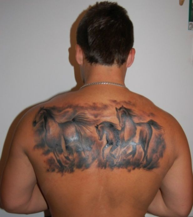 Running wild horses tattoo on back for men