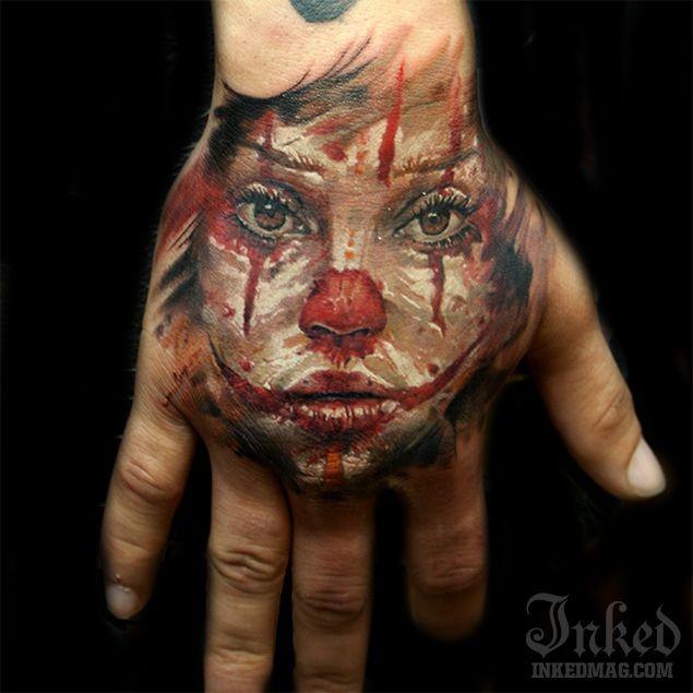 Sad clown girl tattoo on hand