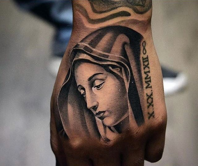 Sad Virgin Mary religious memorial tattoo on hand with Roman memorial date and infinity symbol