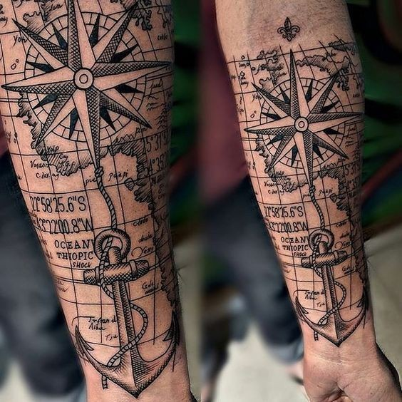 Sailing themed creative looking black ink forearm tattoo of sea star with anchor and map