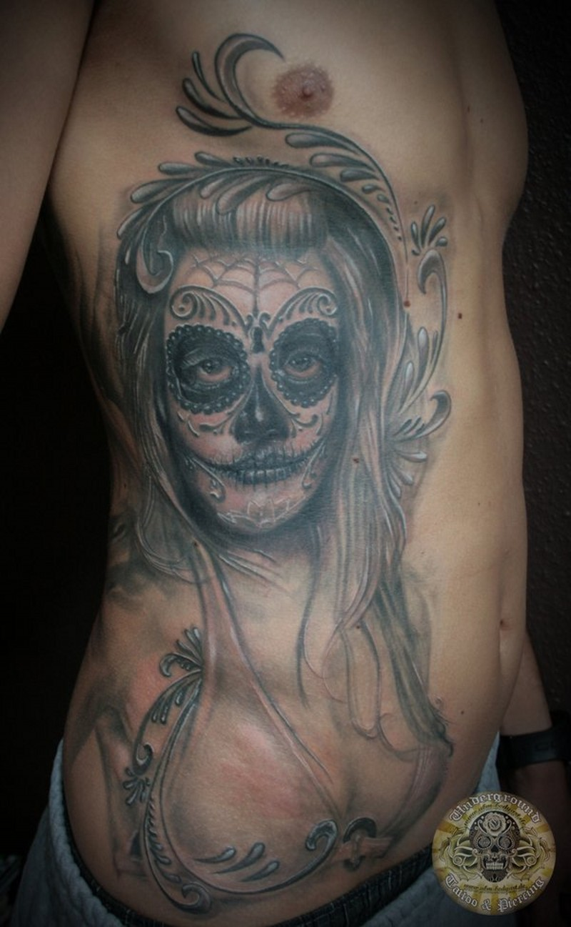 Santa muerte girl tattoo on ribs