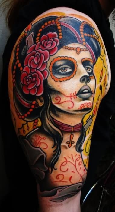 Santa muerte with a burning candle in hair tattoo on shoulder