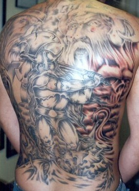 Scandinavian gods and viking with ax tattoo on back