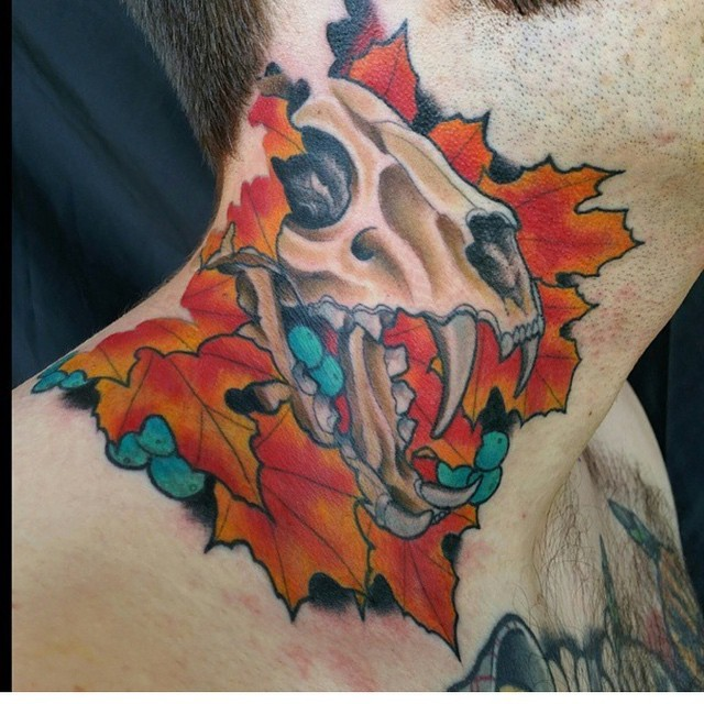 Scary animal skull and autumn colored leaves colored detailed neck tattoo with shadow