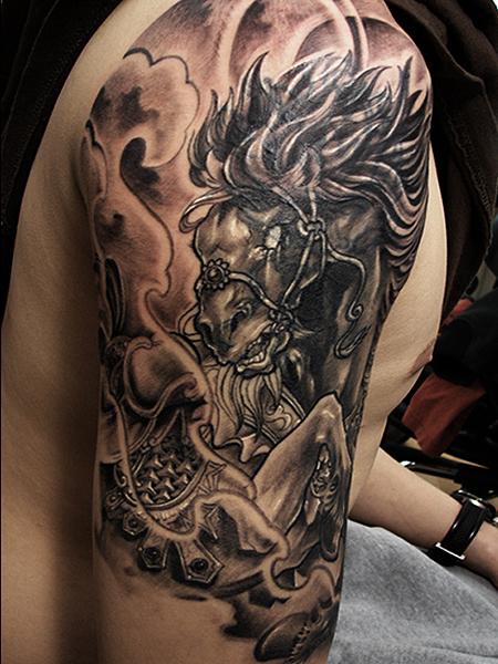 Scary dark horse tattoo on half sleeve