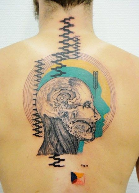 Science style colored upper back tattoo of human face with various ornaments