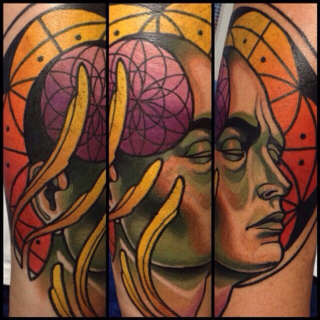 Science themed colored tattoo of human face wutg planet