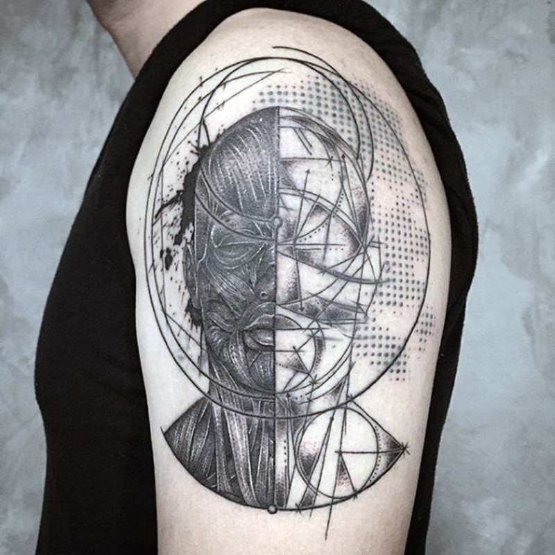 Scientific style black and white man tattoo on upper arm