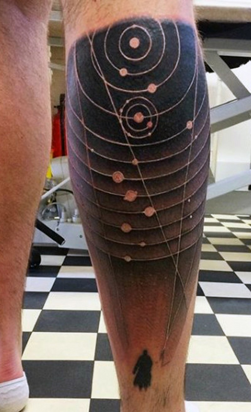 Scientific style black and white solar system tattoo on leg