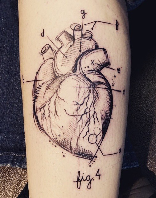 Scientific style black in human heart tattoo stylized with numbers and lettering