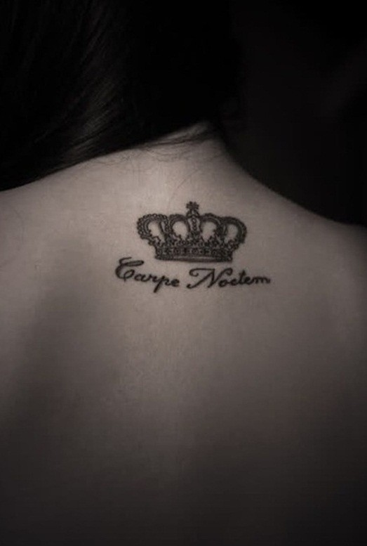 Script and crown of king tattoo on back