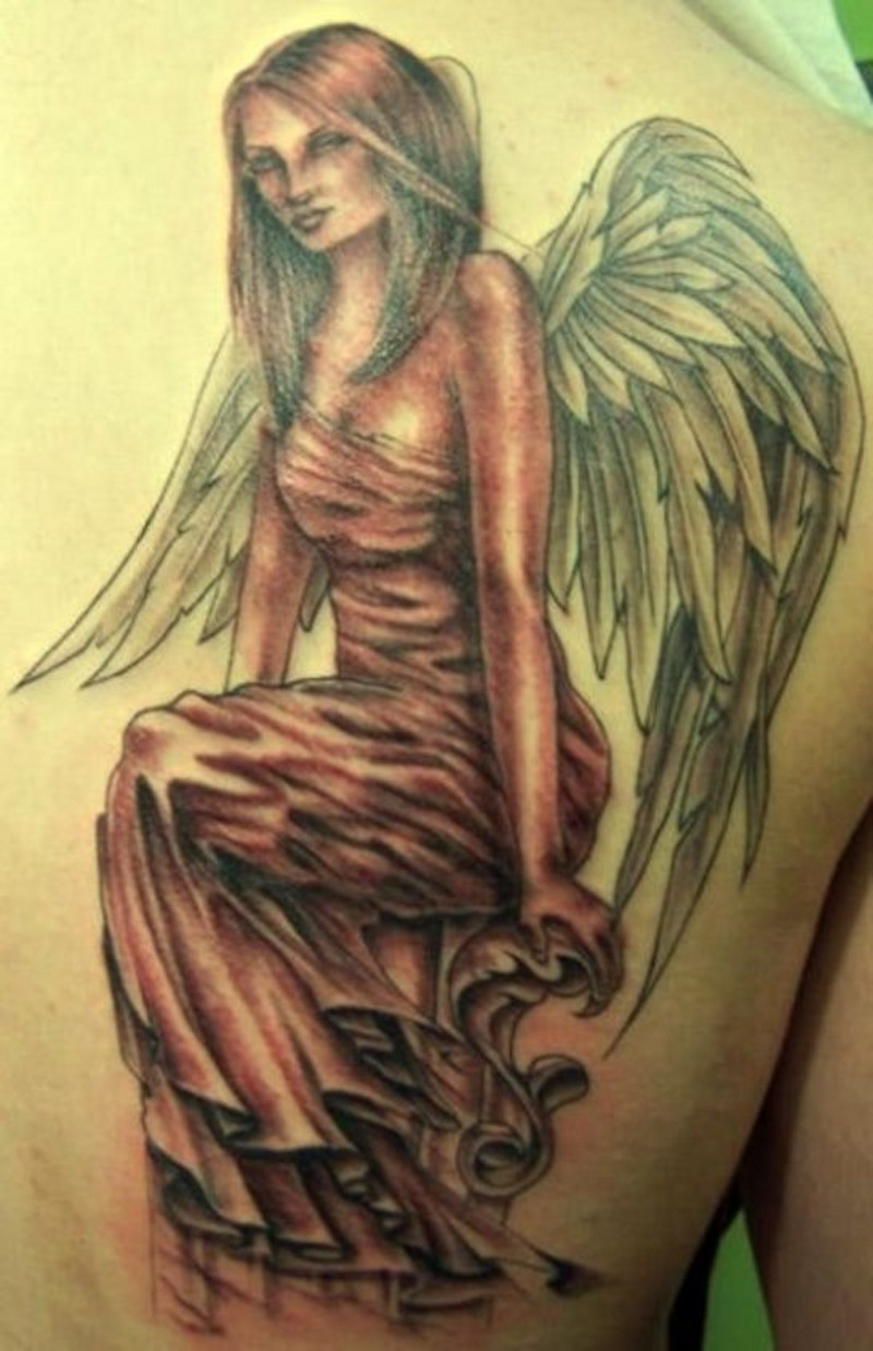 Seated woman angel tattoo on back