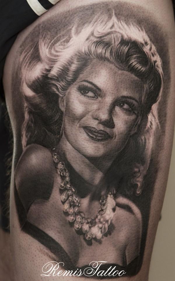 Seductive black and white woman portrait tattoo on thigh