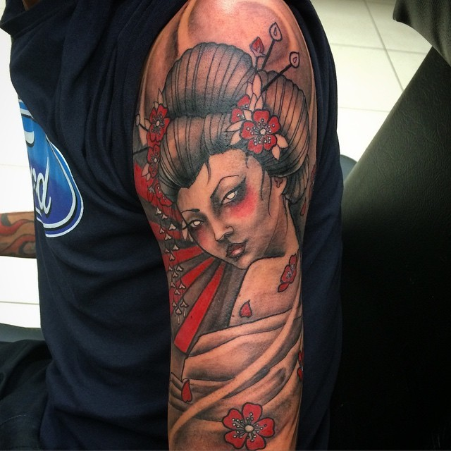 Seductive colored big beautiful shoulder tattoo of geisha