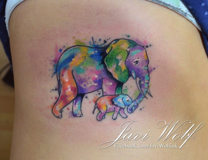 Sentimental mother and baby elephant colored tattoo on woman&quots side in watercolor style by Javi Wolf