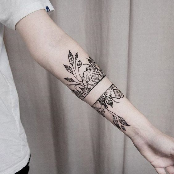 Separated black ink forearm tattoo of wild roses