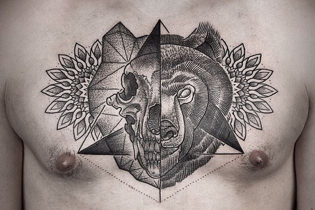 Separated black linework style chest tattoo of animal skull with bear head