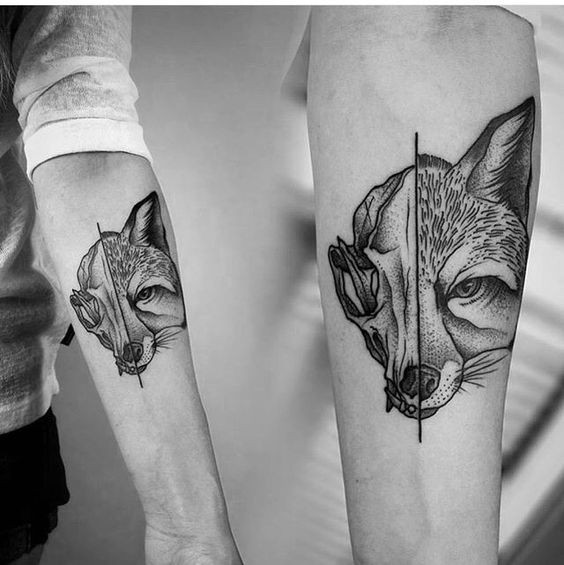 Separated dot style forearm tattoo of animal skull and fox head