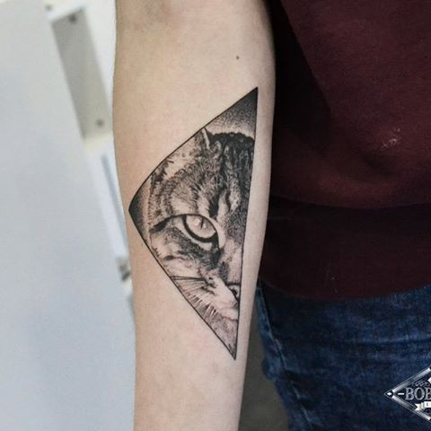 Separated dot style forearm tattoo of cat triangle portrait