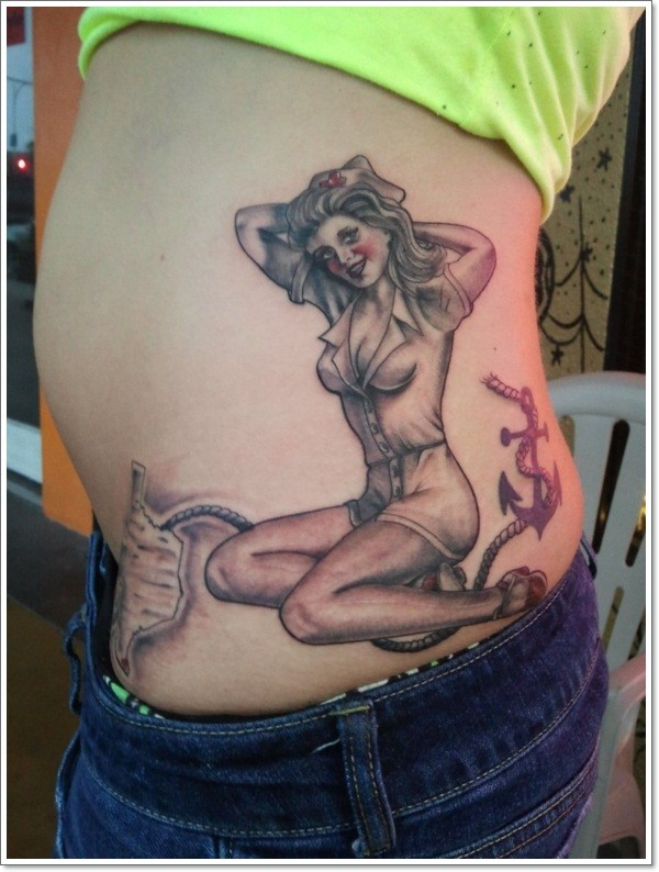 Sexy pin up girl in nurse costume and roped anchor realistic tattoo on waist