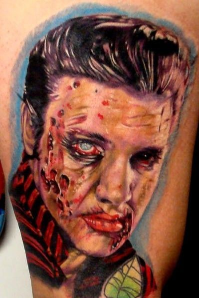 Sharp deigned and colored bloody zombie Elvis tattoo on thigh