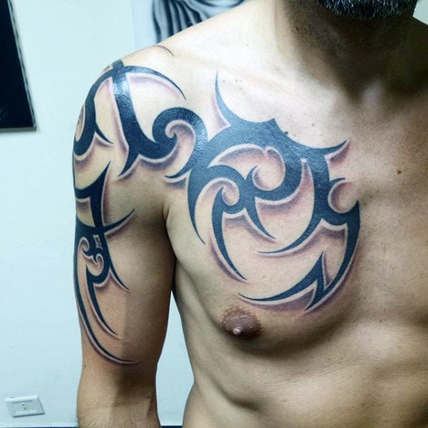 Sharp design dark black ink tribal style ornament tattoo on chest and arm