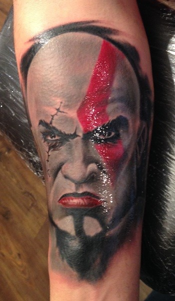 Sharp designed and colored evil barbarian portrait tattoo on forearm