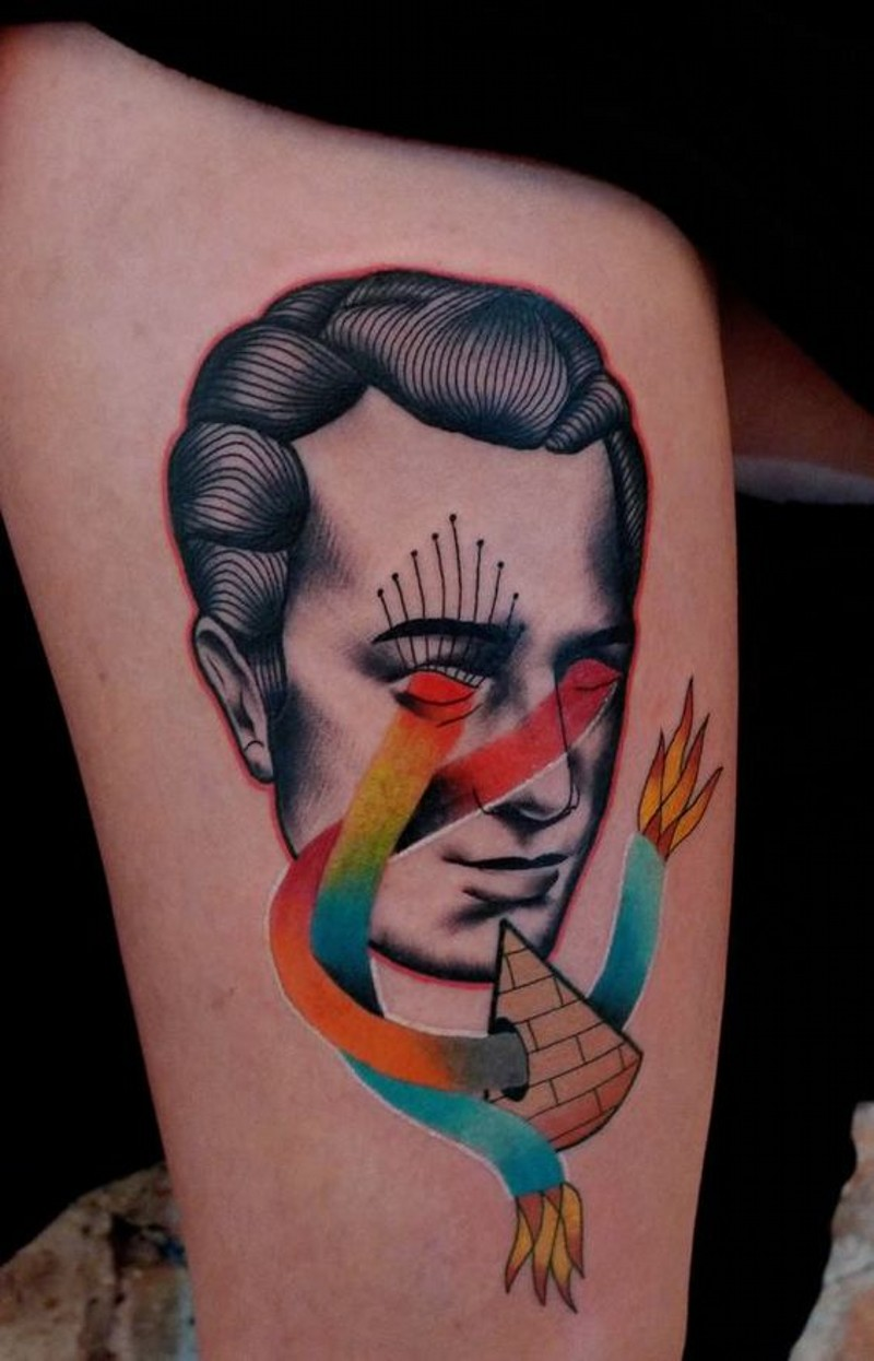 Sharp designed and colored stupid portrait tattoo on thigh